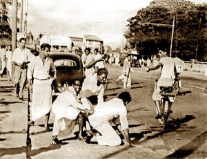 Riots May 1958 - A Tamil passenger was taken out of the vehicle and beaten up. Photo courtesy of Victor Ivan