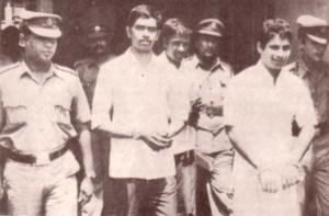 N. Thangathurai and Kuttimani Yogachandran amidst prison guards before they were massacred